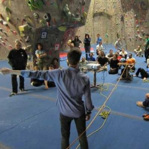 Tim Keenan making a GCC presentation at the Cliffs of Valhalla climbing gym.