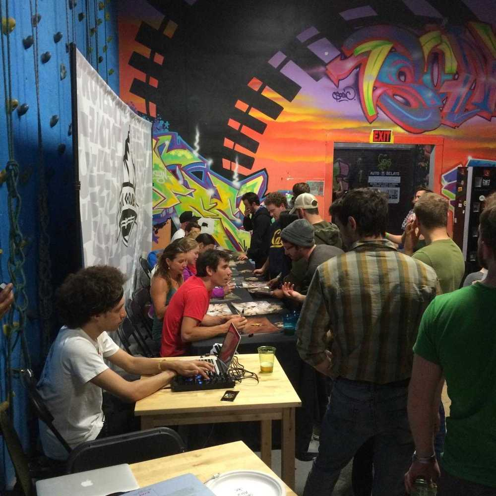 ROCK Project professional climbers autographing posters.