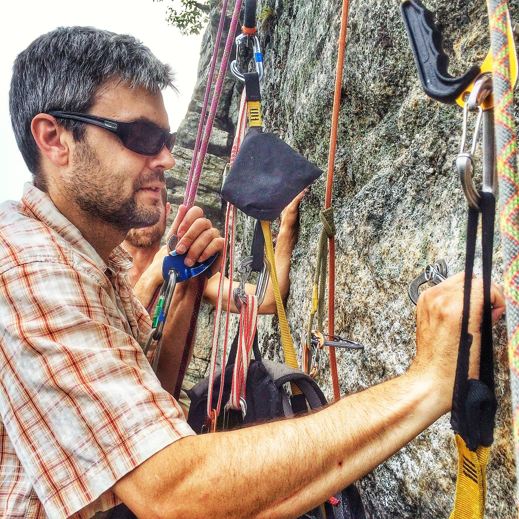 Christian Fracchia replacing the old bolt on the climb Turdland at the Gunks.