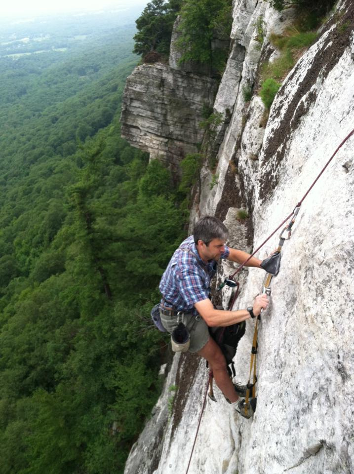 Christian Fracchia of the Gunks Climbers' Coalition, installing a new bolt on the climb, Arrow.