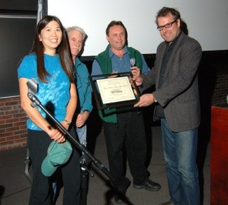 Jannette Pazer (GCC Secretary), Jon Ross (Mohonk Preserve Visitor Services Coordinator and long time Gunks Guide), Glenn Hoagland (Mohonk Preserve Executive Director), and Chris Moratz (GCC Co-Chairman) accepting the Thom Scheuer Award for Land Stewardship for the Gunks Climbers' Coalition at the New Paltz Climbing Film Festival.