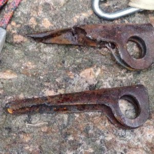 The rusted old anchor pins on the climb