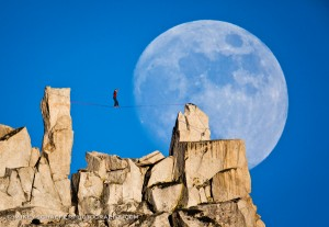 Dean Potter slacklines against a full moon; Photograph by Mikey Schaefer