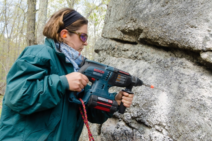 Mohonk Preserve Ranger Elizabeth Elliott drills a hole to place a bolt. Photo: Jeffrey D. Haines