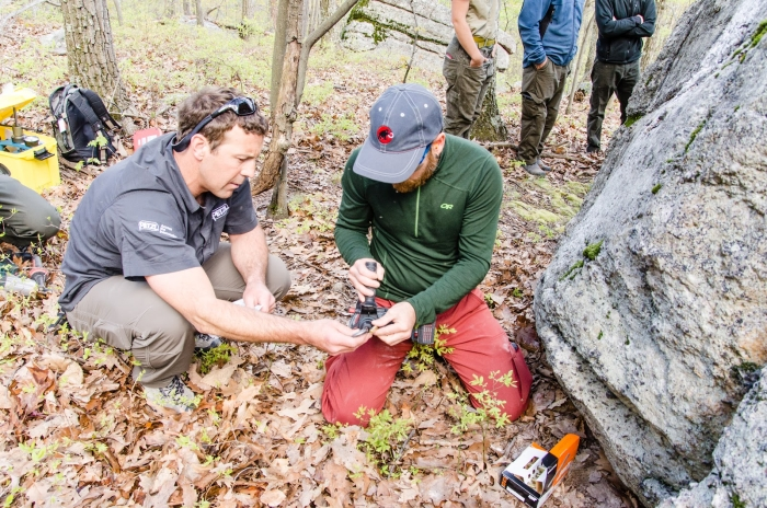 Petzl Technical Institute Manager Jesse Williams works with GCC volunteer Jason Hurwitz in the field, learning how to bolt for climbing fixed anchors. Photo: Jeffrey D. Haines