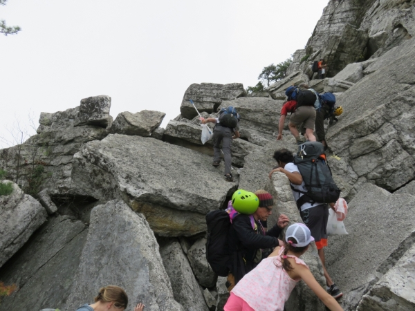 Volunteers working their way up the difficult talus terrain of the Bonticou Crag Ascent Path in the Mohonk Preserve. for the Gunks Climbers' Coalition Adopt-A-Crag day clean up.