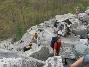 Volunteers working their way up the talus of the Bonticou Crag Ascent Path in the Mohonk Preserve. for the Gunks Climbers' Coalition Adopt-A-Crag day clean up. (photo: Jannette Pazer)