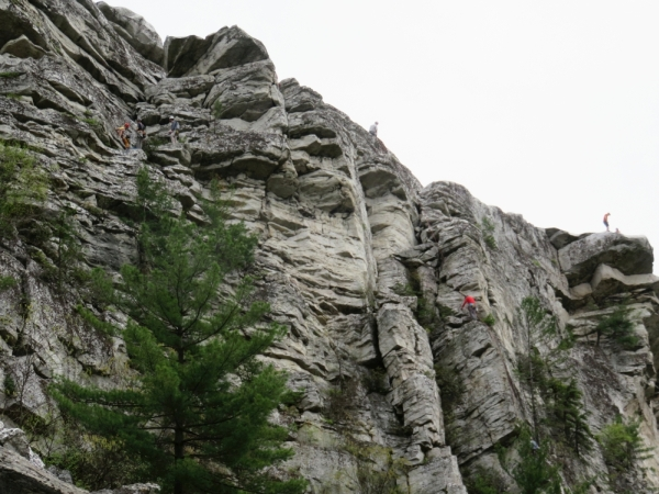 Rock climbers on Bonticou Crag in the Mohonk Preserve, for the Gunks Climbers' Coalition Adopt-A-Crag day clean up.
