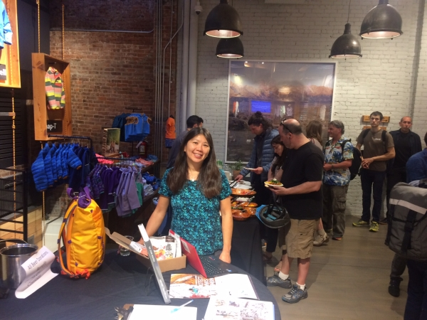 Jannette Pazer mans the GCC table at Tommy Caldwell's book event at Patagonia Soho in NYC on 5/16/2017.