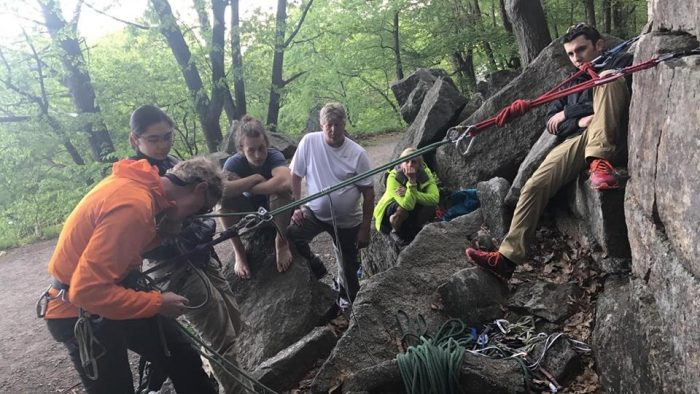 Climbing guide Alan Kline teaches haul systems to attendees of the Saturday Night Live free climbing clinics at the Gunks in May 2017. (photo: Tyler Shelley)