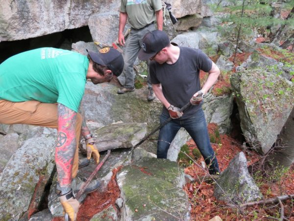 Moving rocks to make a more stable trail at the base of the Lost City Cliff, GCC Adopt-a-crag day, May 2018.