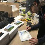 Photographer, Chris Vultaggio, signing his photographs to benefit the Gunks Climbers' Coalition, in preparation for the Patagonia Holiday Party.