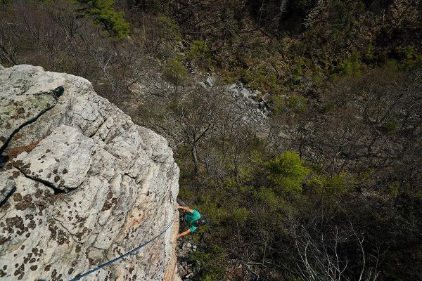 Climber on Ant Lion cliff on Millbrook Mountain in the Gunks, purchased by the Gunks Climbers' Coalition.