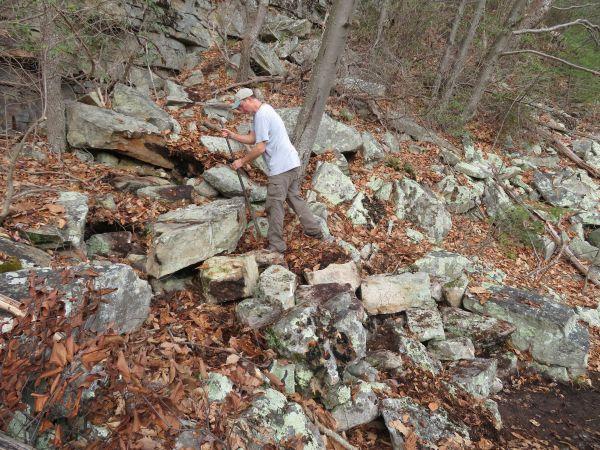 Matt building stone steps at the Antlion cliff in the Gunks.