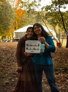 Jannette & daughter Ariel showing the signs they installed around the Gunks Climbing Film Festival, 2020