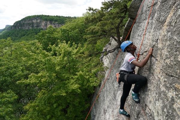 Young Women Who Crush mentee Monifer, rock climbing in the Shawangunks.