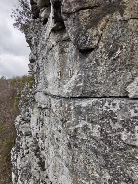Newly installed bolt anchors at Antlion Cliff.